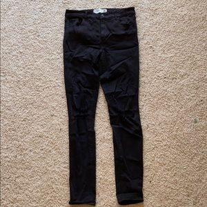 Black Super Skinny jeans w/ rips in both knees
